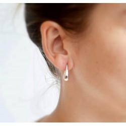 Silver earrings in water drop shaped